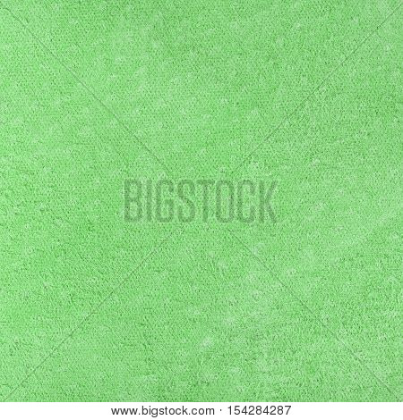 Green leatherette texture flesh side. Square close up