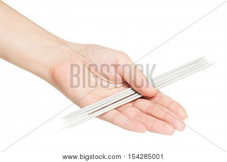Knitting spokes in a woman hand isolated on white background cutout