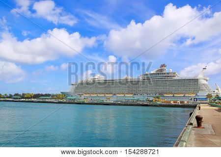 Nassau, Bahamas - April 13, 2015: Royal Caribbean cruise ship Allure of the Seas  docked at port of Nassau, Bahamas on April 13, 2015. It's the largest passenger ship ever built