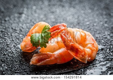 Closeup of fresh seafood on a black rock