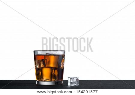 Whiskey on the rocks in glass with ice cubes isolated on white background with copy space