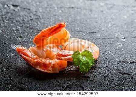 Closeup Of Shrimps Served On A Wet Rock