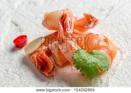 Closeup of fresh seafood on a white rock