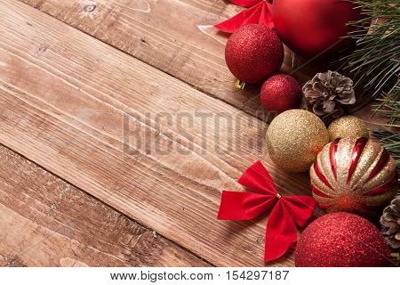 Red Christmas Balls, Pine And Cypress Cones With Twigs On Wood Table