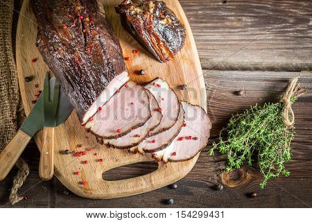 Closeup Of Fresh Piece Of Smoked Ham And Herbs