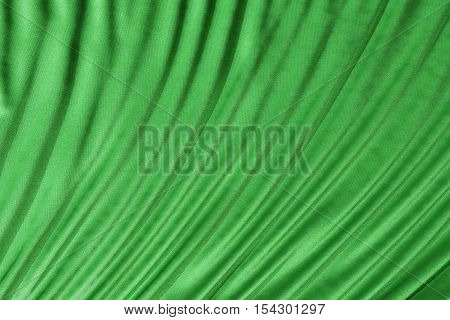 Green fabric folds. Smooth drapes cloth decoration. 3d render