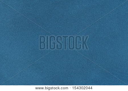 Blue knitwear fabric texture background. Close up