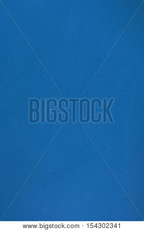 Cyan smooth fabric texture background close up
