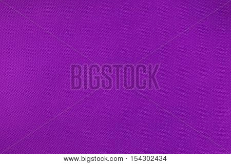 Violet flax fabric texture background. Close up