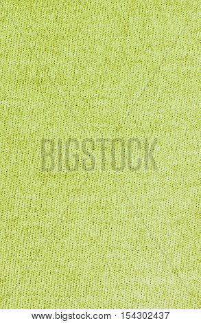 Yellow knitwear fabric texture background. Close up