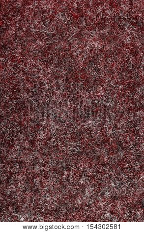 Red fluffy felt texture background. Close up