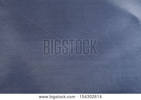 Blue wrinkled  fabric texture background. Close up