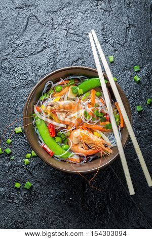 Chinese mix vegetables and rice noodles on black rock
