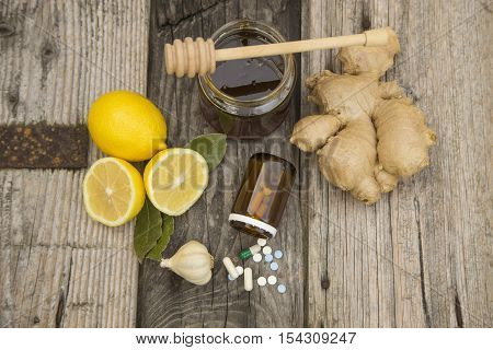 Gingerlemonhoney and garlic fresh and healthy food products concept for natural medicine.