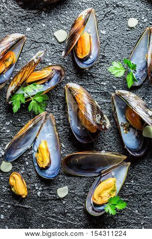 Mussels served with garlic and parsley on black rock