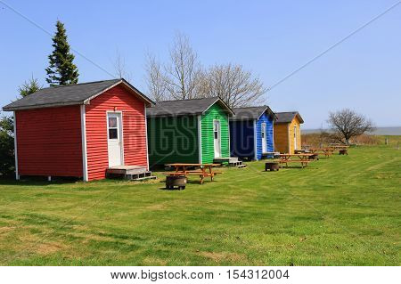 Colorful Shacks With Picnic Tables