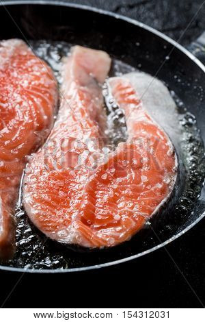 Closeup of fresh salmon fried in the pan