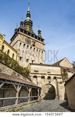 View to the watch tower and architecture in Sighisoara town, Romania