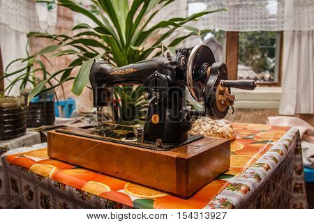 old sewing machine on the table Village House