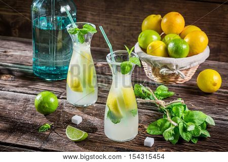 Fresh cold drink lemon with sugar on wooden table