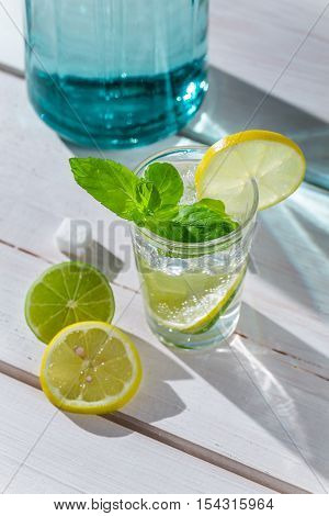 Cold Drink With Ice, Citrus Fruits And Mint Leaf