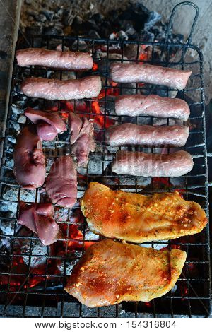 Meat on the grill raw chicken steak chicken liver and kebabs on hot grill