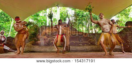 Yirrganydji Aboriginal man dance to Aboriginal music during Aboriginal culture show in Queensland Australia.
