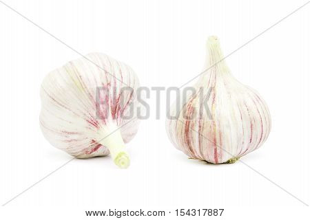Two heads of garlic on a white background