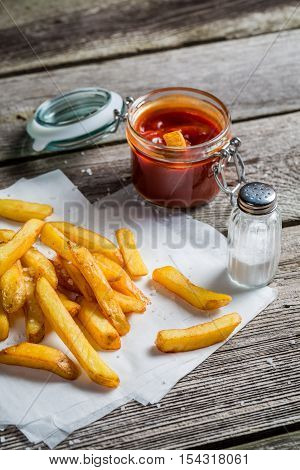 Fresh French Fries Served With Ketchup And Salt
