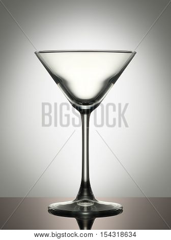 Empty martini glass on a white background.