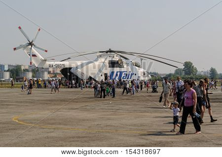 Tyumen, Russia - August 11, 2012: Air show On a visit at UTair in heliport Plehanovo. People explore MI-26T helicopter biggest in world