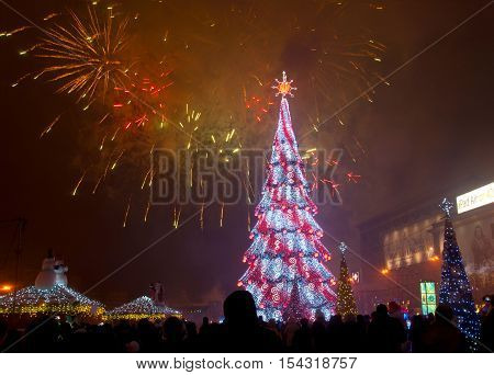 FREEDOM SQUARE KHARKIV UKRAINE - DECEMBER 21 2013: firework above Christmas tree Kharkov Ukraine on December 21 2013. Preparation for the celebration of the New Year at the square in Kharkov