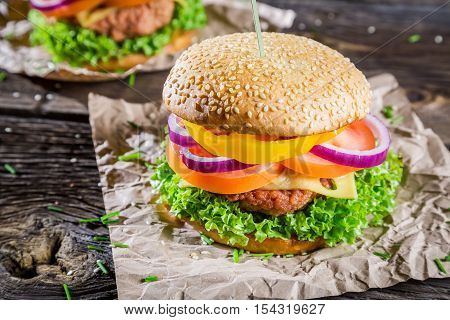 Two burgers made from fresh vegetables on wooden table