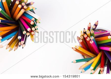Set of color pencils in two office bins in different corners