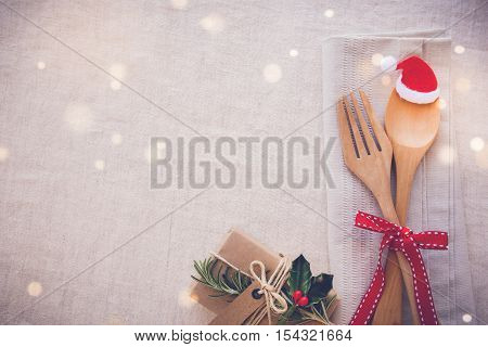 Christmas table place setting holidays copy space fairy light toning background