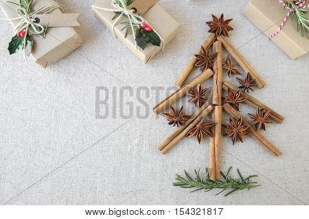 Christmas Tree Made From Anise Star Seeds And Cinnamon Sticks With Eco Present Boxes, Copy Space Bac