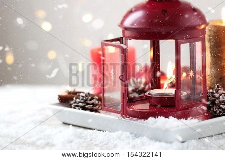 Christmas lantern with candles snow christmas decorations and fir cones horizontal with copy space
