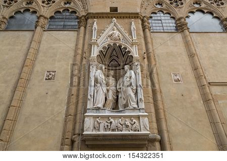 FLORENCE, ITALY - SEPTEMBER 2016 : Statue of 4 Crowned Martyrs of Four Saints Group (Guild of Stone and Wood Masters) by Nanni di Banco, Church niche figures in Florence, Italy on September 21, 2016