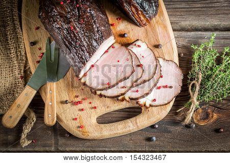 Delicious smoked homemade ham cooked on wooden table