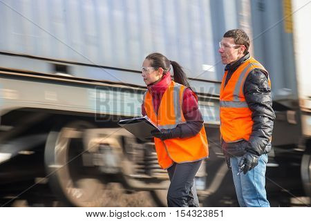 Workers at a railway inspecting train cargos