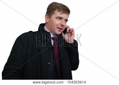 Portrait of a handsome business man talking on mobile phone isolated on white.Closeup of serious successful man in a suit talking on cell phone.