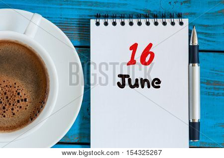June 16th. Image of june 16 , calendar on blue background with morning coffee cup. Summer day, Top view.