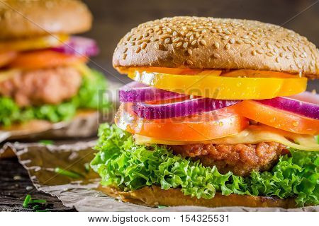 Burger made from vegetables and beef on wooden table