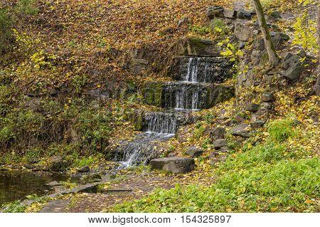 Waterfall on the stones in the autumn season