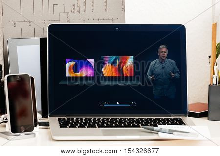 PARIS FRANCE - OCT 28 2016: Apple Computers website on new MacBook Pro Retina with OLED Touch bar in geek creative room showcasing Apple Keynote - Philip Schiller comparing new MacBook Pro Retina