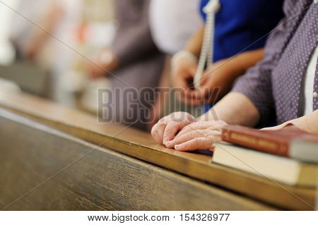 Senior Woman Praying In A Church