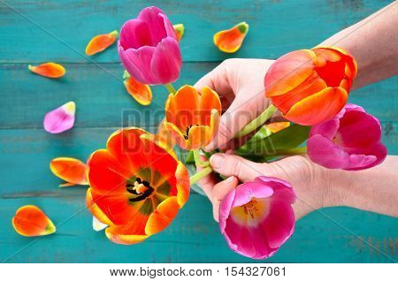 Woman Hands Organizing And Assorting Tulip Flowers Bouque
