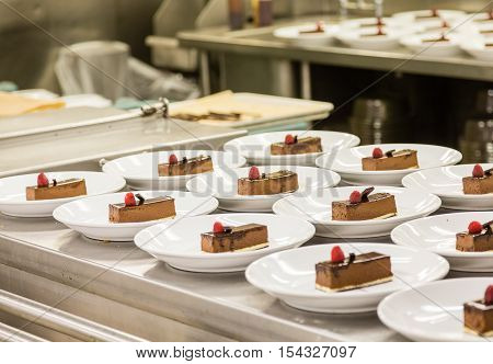 Chocolate desserts plated in a commercial kitchen