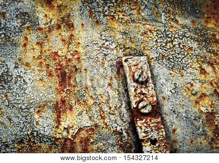abstract background rusty joints with bolts on an old metal