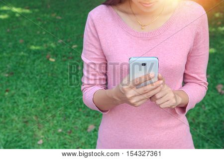Closeup of woman hand holding using mobile smartphone